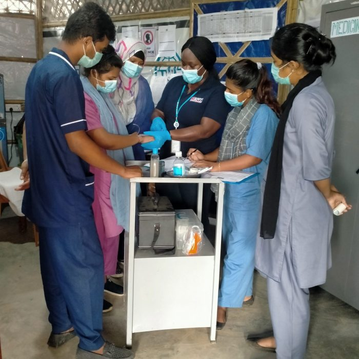 Midwife Sophie Otieno trains Bangladeshi nurses and midwives how to canulate (UK EMT Team Two, August 2020)
