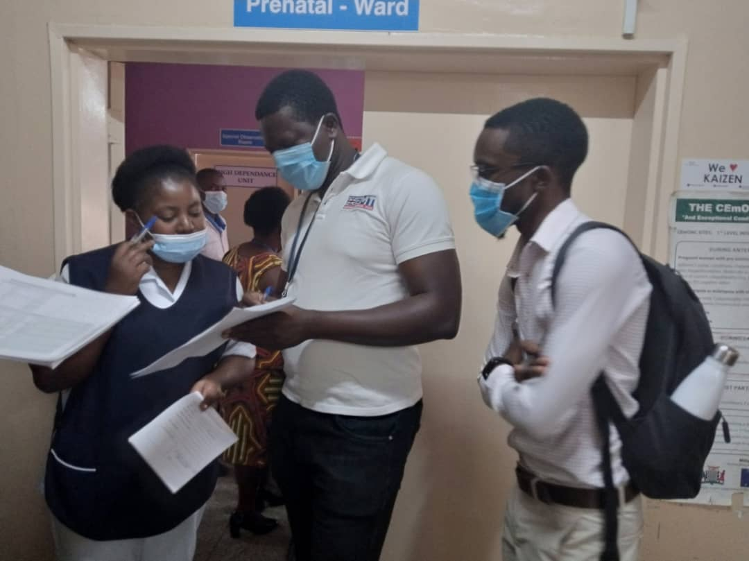 UK-Med's Jude Chimaobi Akuechiama with IDinsight at Kayama Hospital, Lusaka district.