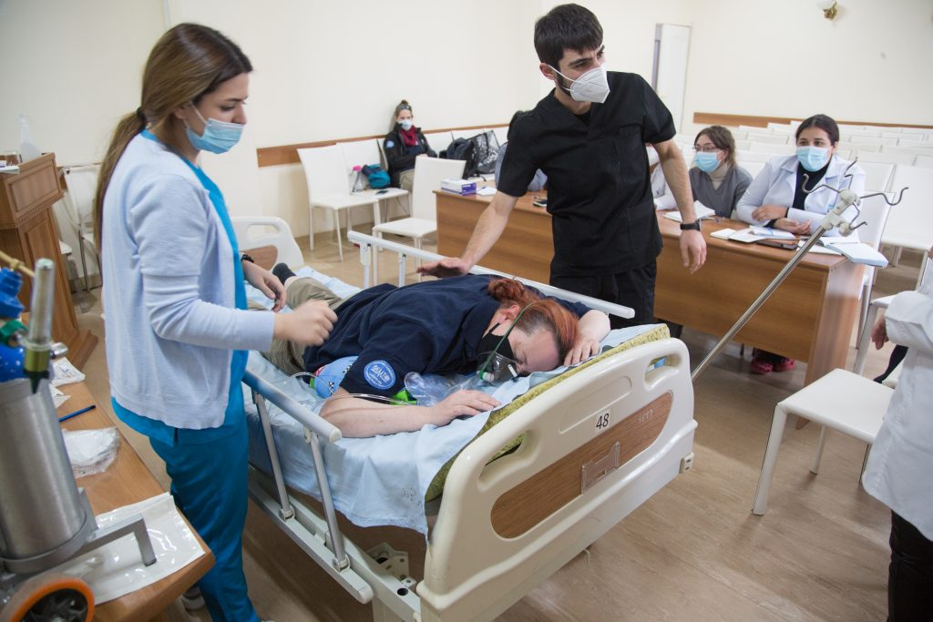 Critical care nurse Trish McCready as patient during training at Surb Grigor Lusavorich Hospital, Yerevan, Armenia.