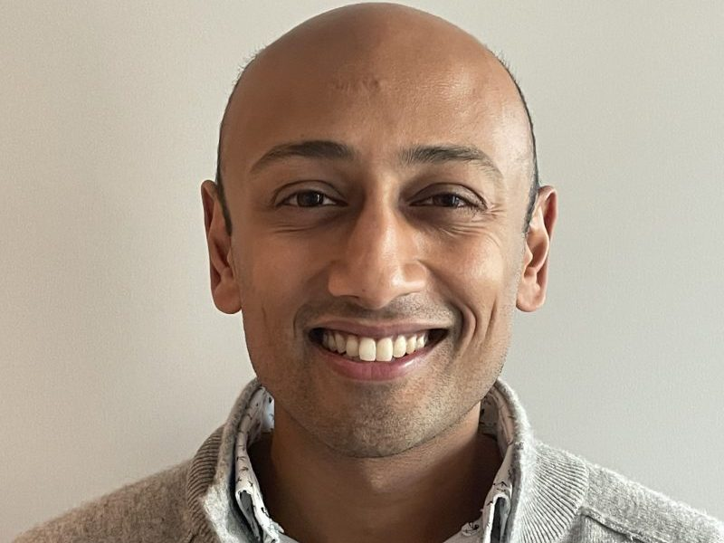 Close-up photo of Ram smiling.