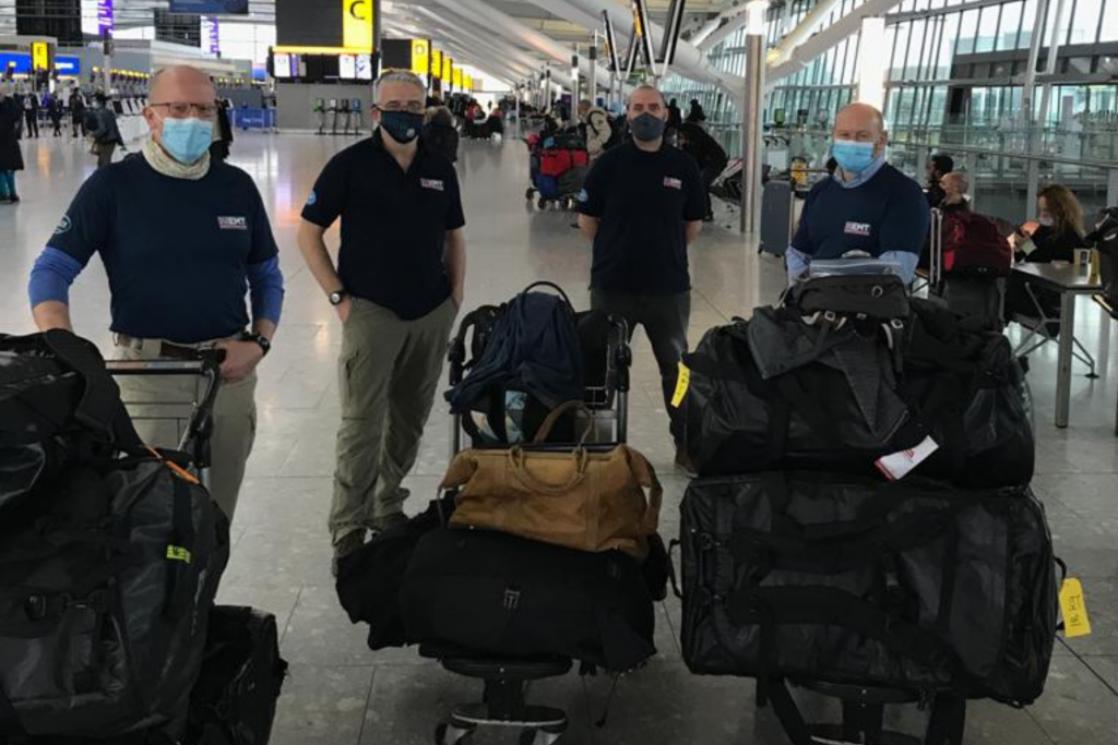 UK Med team as part of the UK EMT fly to Eswatini from London, Heathrow. (A Kent, 2021).