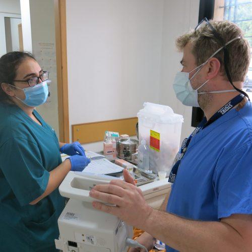 ICU nurse John Irvine conducts clinical coaching with nurse Katya el Khoury at Baabda hospital COVID ward. (D Ritzau-Reid, Lebanon 2020)
