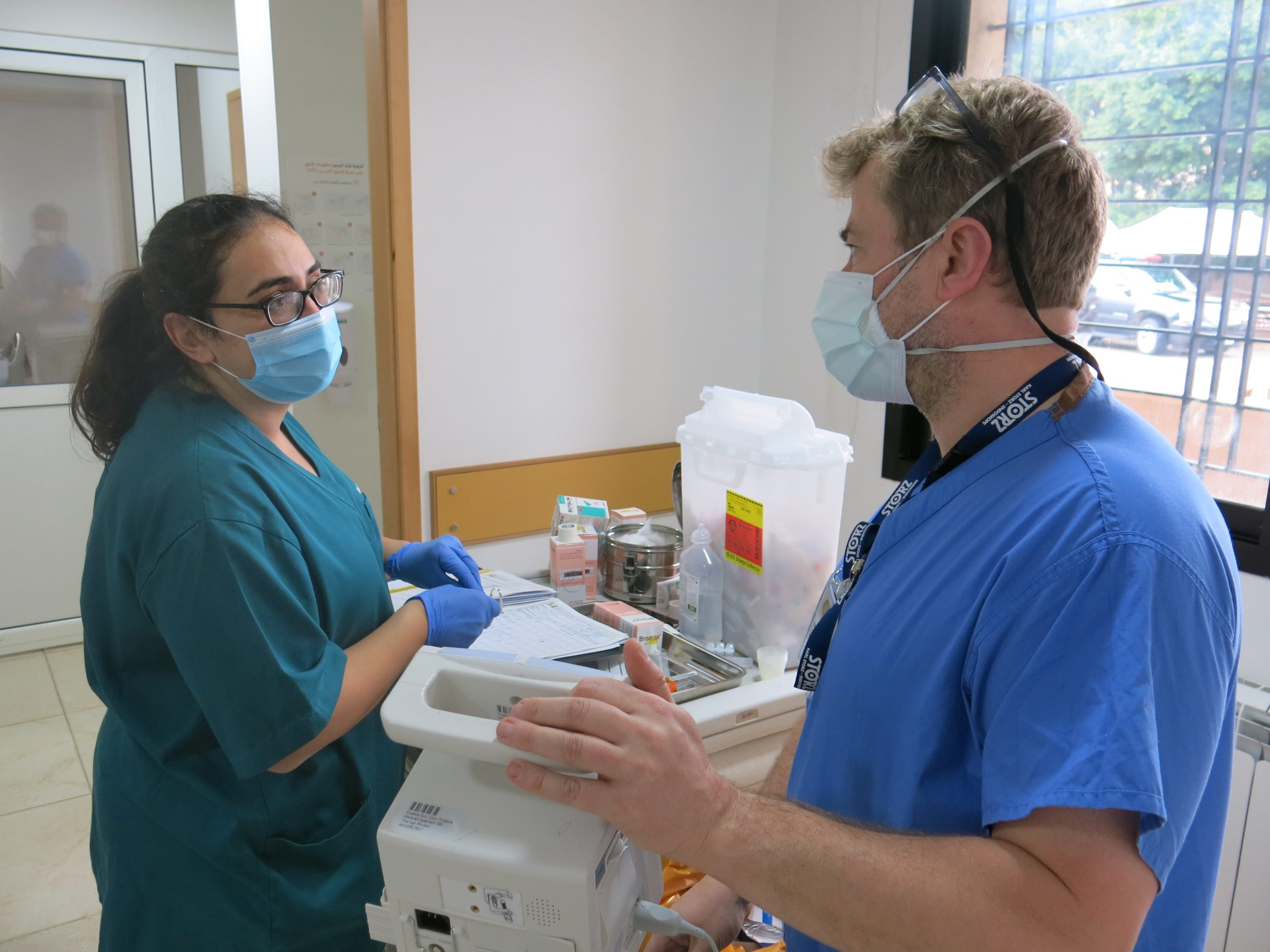 ICU nurse John Irvine conducts clinical coaching with nurse Katya el Khoury at Baabda hospital COVID ward. (D Ritzau-Reid, Lebanon 2020)