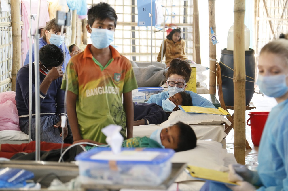 Kathleen treating patients inside a Diphtheria Treatment Centre in Cox's Bazar, Banglasdesh. Photo credit: R Watkins (2017)